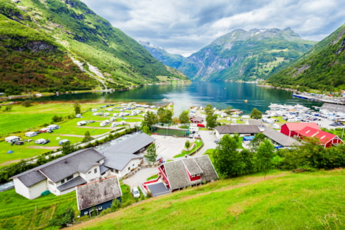 Geiranger is a small tourist village in Sunnmore region of Norway. Geiranger lies at the Geirangerfjord