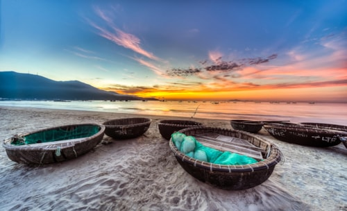 My Khe beach is a beautiful beach in Danang city , Vietnam. The sunrise is on creels , ( fishing boats in Vietnam ). My Khe Beach is in Top 6 beautiful beach in the World By Forbes Magazine