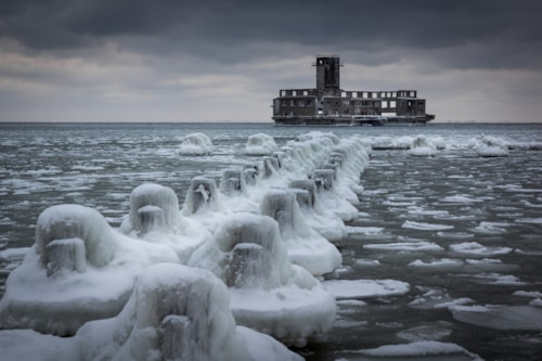Frozen Baltic sea and ruins old military building in Babie Doly, Gdynia, Poland