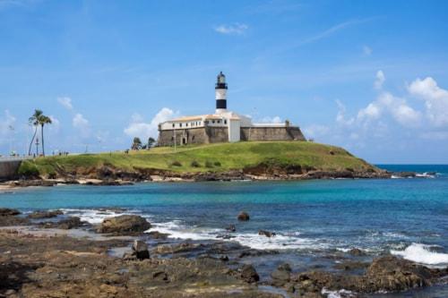 View of famous Farol da Barra (Barra Lighthouse) in Salvador, Bahia, Brazil.